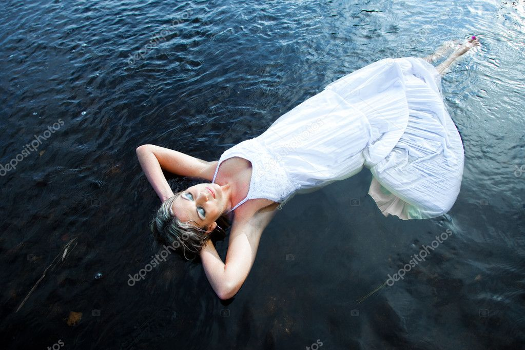 Woman floating in blue river
