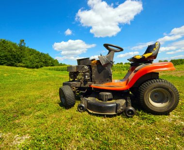 Wide angle old riding mower.
