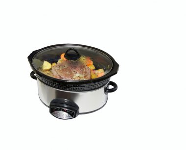 Slow cooker with roast beef and vegetables.