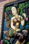 Socha žena thajské umění v thajském chrámu