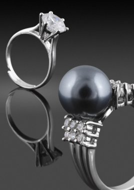 Rings with pearl and diamonds
