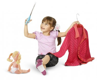 Little girl is playing with scissors