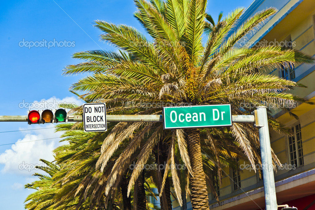 Street sign of famous street Ocean Drice in Miami South with tra