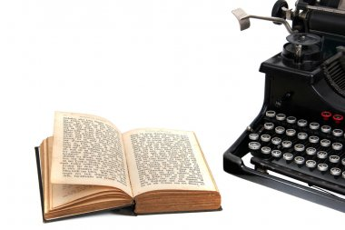 Typewriter with old book