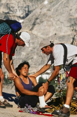 Injured climber being rescued.