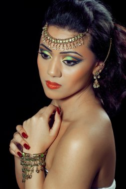 Beautiful asian/indian woman with bridal makeup and jewelry