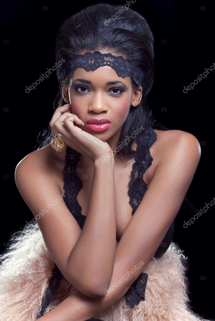 Beauty shot of a young beautiful model, isolated on black