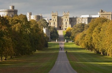Windsor Castle viewed along Long Walk in Windsor Great Park in E