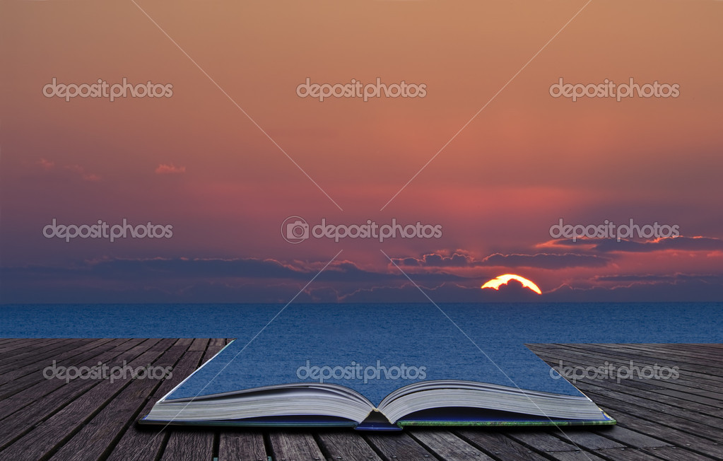 Magical book with contents spilling into landscape background