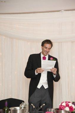 Groom makes speech during wedding reception