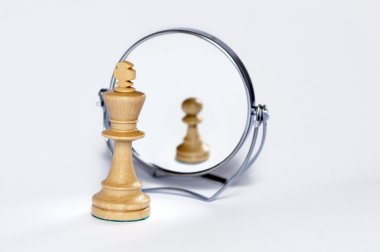 Chess king, chess pawn, contrast, reflection,
