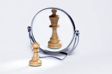 Chess pawn, chess king in mirror reflrction