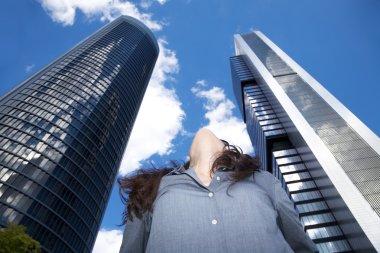 Woman looking at top skyscrapers