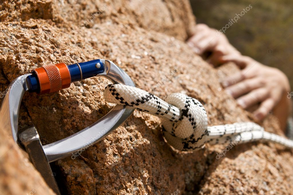 Rockclimber's hands of rising on rock
