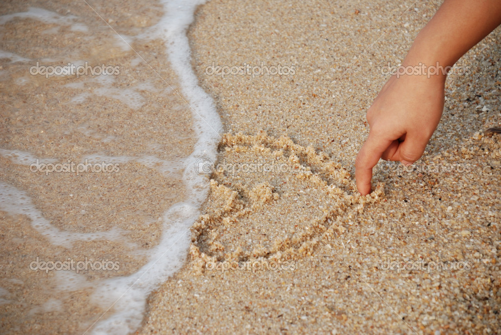 Heart drawing on the sand