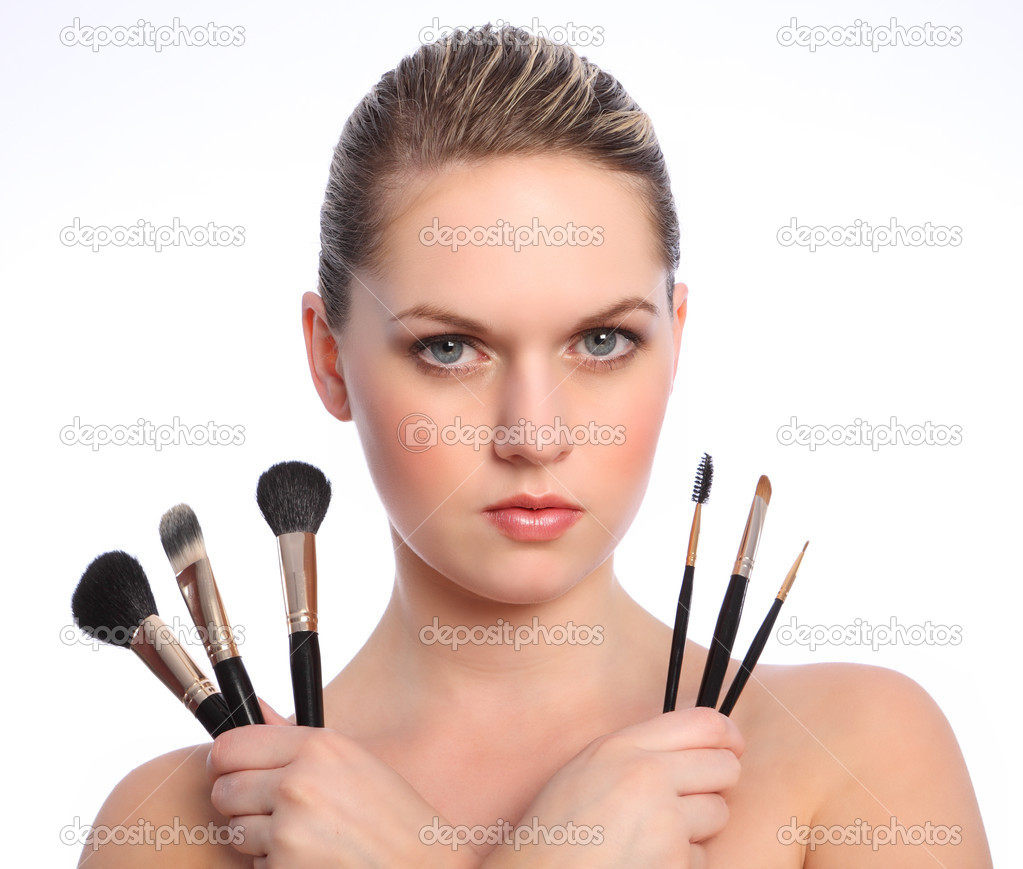 Beautiful make up artist with cosmetic brushes — Stock ...