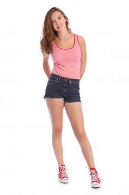 Teenager girl in denim shorts and vest happy smile