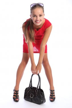 Beautiful happy woman in red dress with handbag