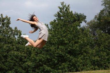 Beautiful sexy woman flying jump for fun success