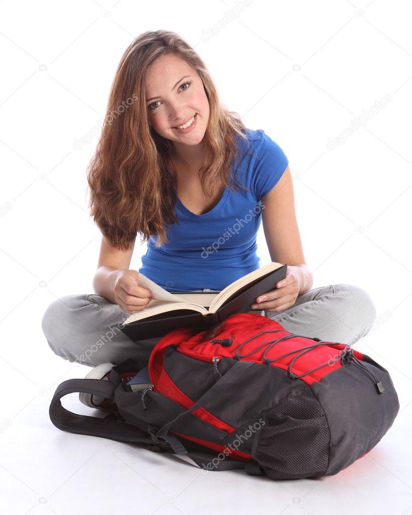 Teenage student girl reading school study book