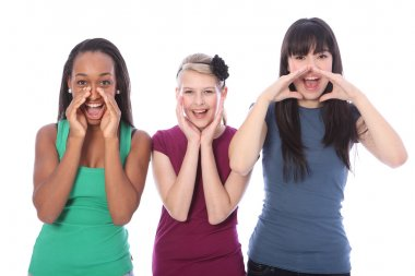 Three mixed race teenage girls shouting out loud