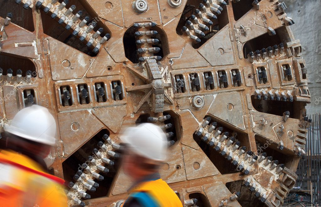 Construction workers huge tunnel machine
