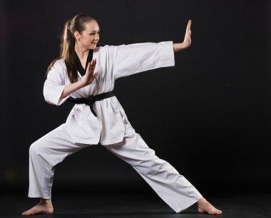 Girl in kimono exercising karate kata