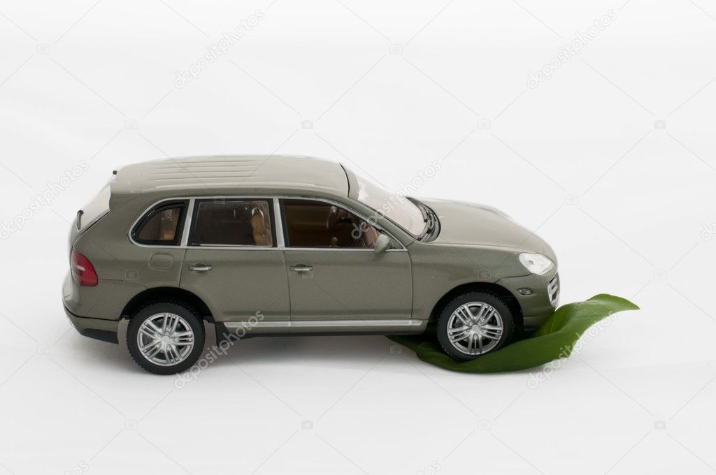 Green leave and a car.Ecology conception