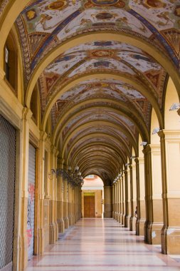 Decorated old portico with columns in Bologna