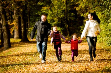 Young family in the autumn park