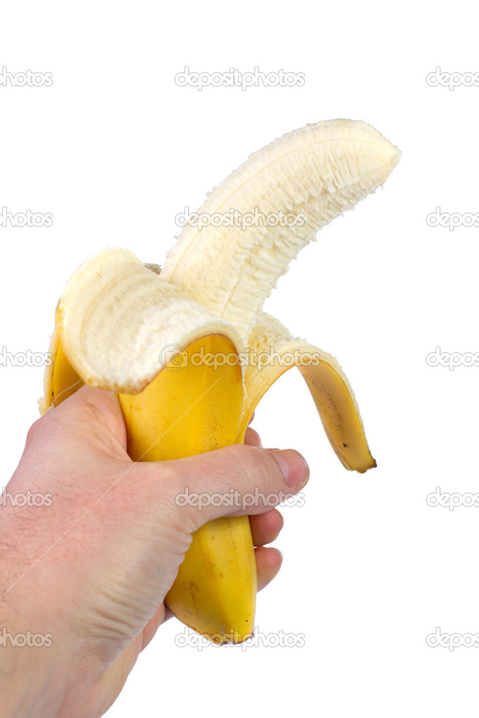 Banana in the hand on white background