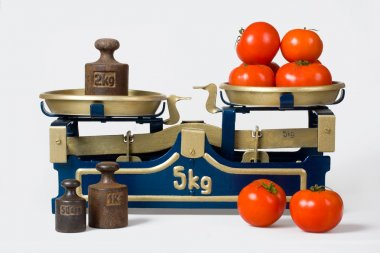 Tomatoes on a vintage scale