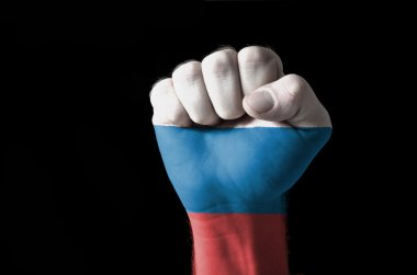 Fist painted in colors of russia flag