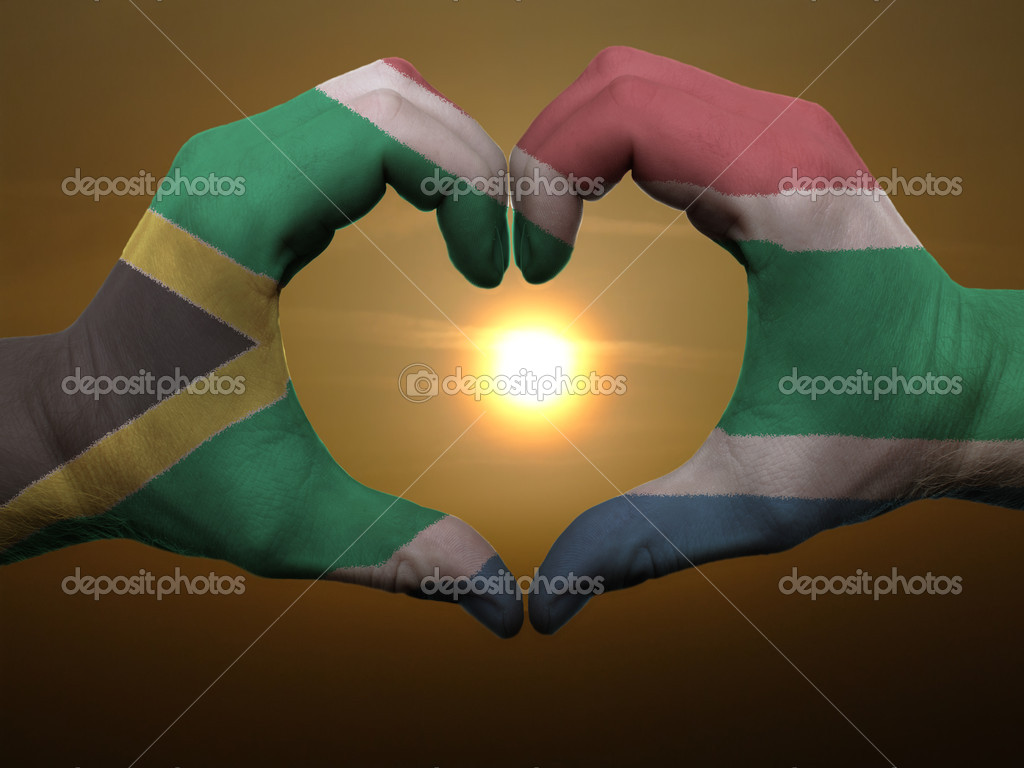 Heart and love gesture by hands colored in south africa flag dur
