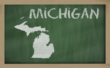 Outline map of michigan on blackboard