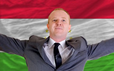 Happy businessman because of profitable investment in tajikistan