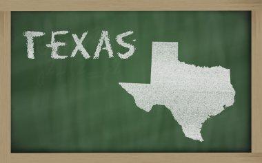 Outline map of texas on blackboard