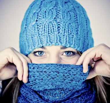 Beautiful girl with a scarf hiding