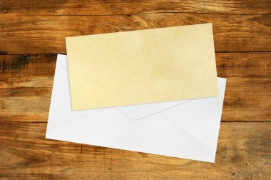 Vintage Envelope with blank Brown paper on wood