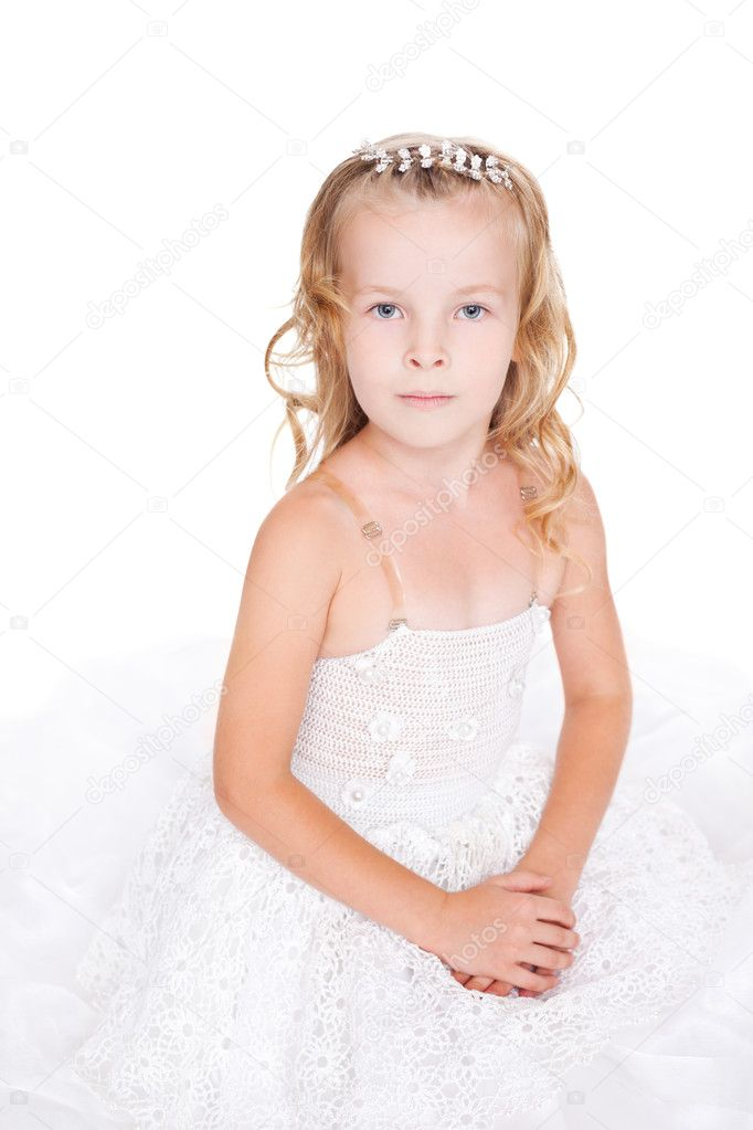 Beautiful little girl in white dress isolated on white backgroun