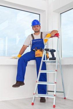 Handyman or worker resting after work