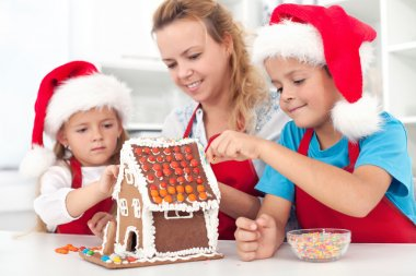 Preparing a gingerbread cookie house