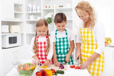 Family preparing fresh salad