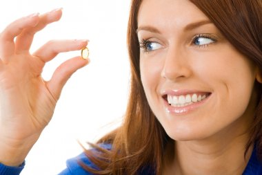 Young happy woman with Omega 3 fish oil capsula, isolated