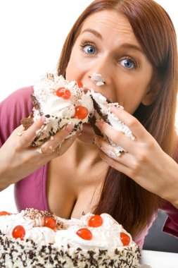 Young hungry gluttonous woman eating pie, isolated