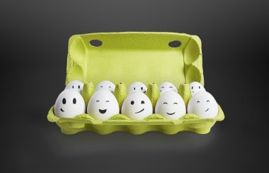 Group of happy eggs with smiling faces representing a social network. Ten white eggs in a carton box. On a black background stock vector