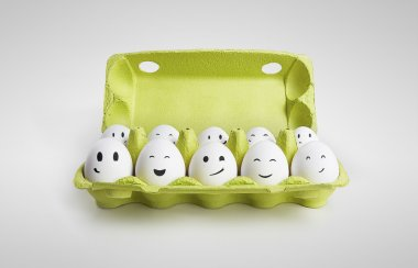 Group of happy eggs with smiling faces representing a social network. Ten white eggs in a carton box. On a gray background stock vector