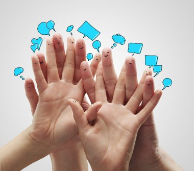 Group of happy finger smileys with social chat sign and speech bubbles