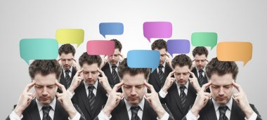Group of businessmen with social chat sign and speech bubbles.