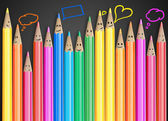 Fotografie Group of coloured smiling pencils with social chat sign and speech bubbles.